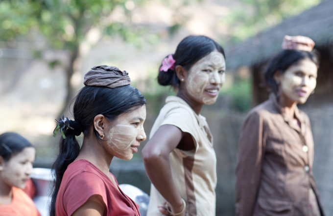 Burmese women with thanaka paste on their faces going to local market