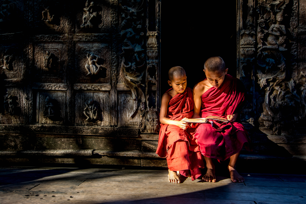 Little Monk reading a book in pagoda, Bagan, Myanmar